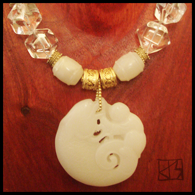CARVED JADE BI ROCK CRYSTAL NECKLACE